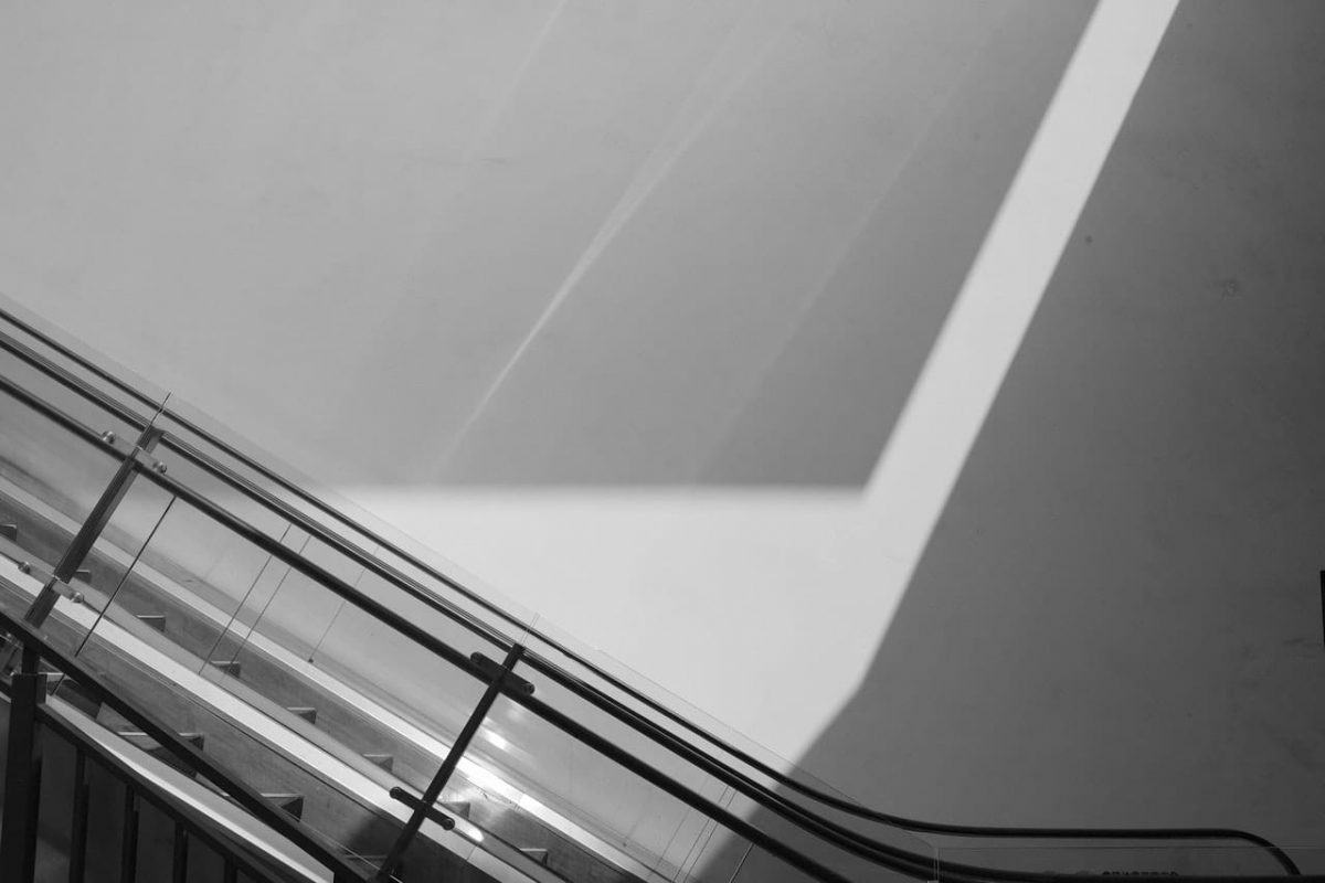 A black and white photo of an escalator